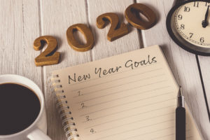 New Year Goals for 2020 on notepad on desk, for the best chiropractic care see Crown Point pain treatments.