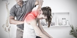 Pain doctor treating patient's neck pain, for pain relief see Crown Point Chronic Pain Treatment.
