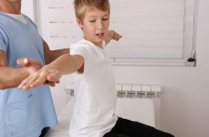 Child attends a consultation with a chiropractor in Schererville.